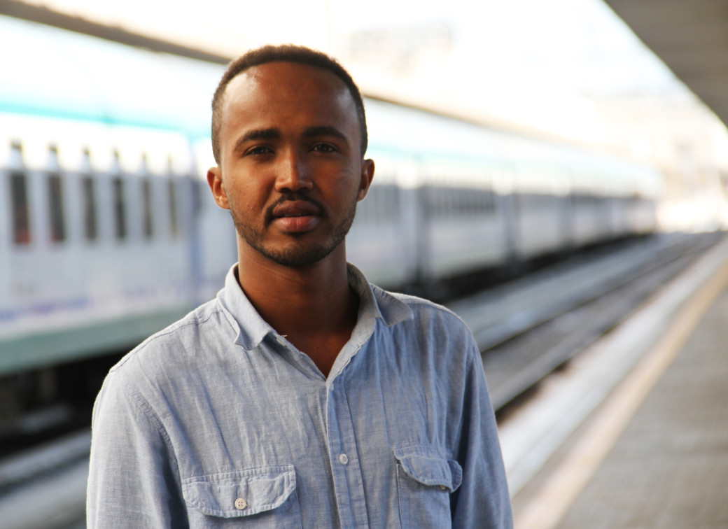 Mohamed stands outside Termini train station. This area is frequented by refugees and migrants